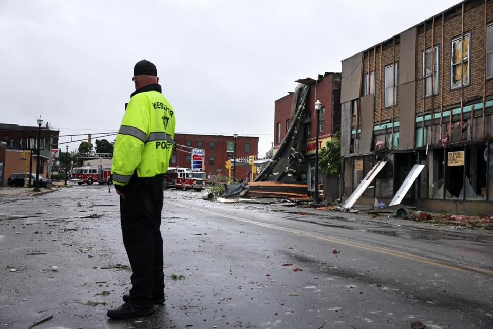 Officer David Powell surveyed damage from Saturday's tornado in Webster.
