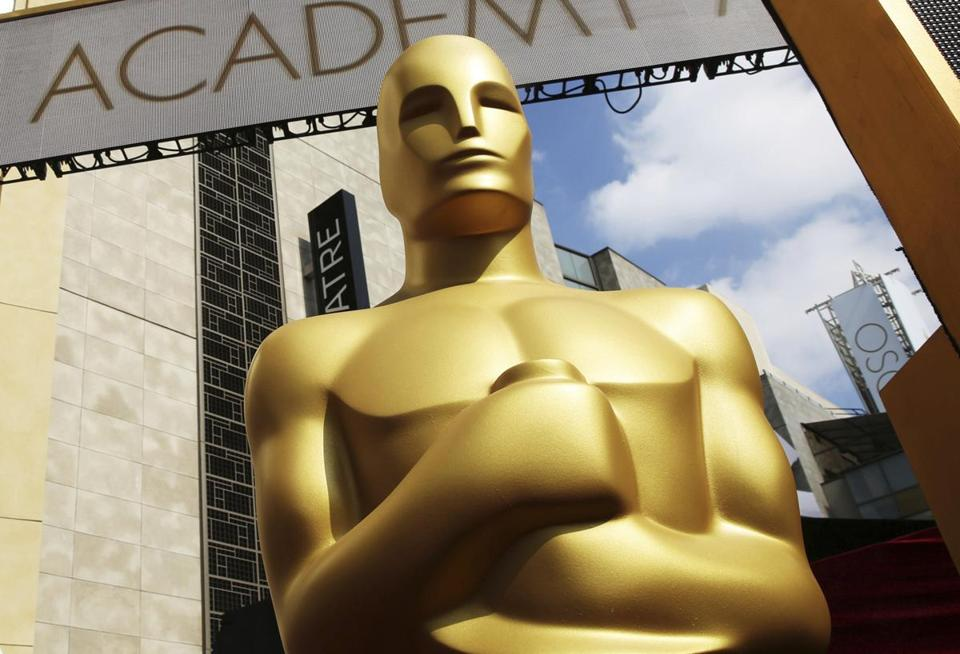 FILE - In this Feb. 21, 2015 file photo, an Oscar statue appears outside the Dolby Theatre for the 87th Academy Awards in Los Angeles. The Oscars are adding a new category to honor popular films and promising a brisk 3-hour ceremony on a much earlier air date of Feb. 9, 2020. (Photo by Matt Sayles/Invision/AP, File)