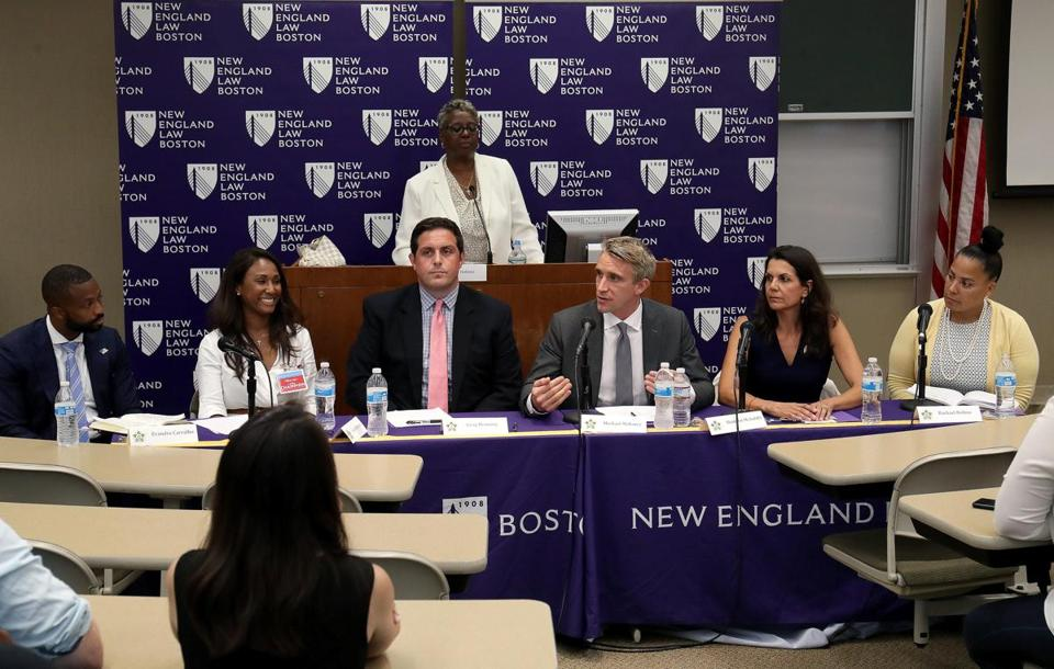 (Left to right) Suffolk County District Attorney candidates Evandro Carvalho, Linda Champion, Greg Henning, Michael Maloney, Shannon McAuliffe, and Rachael Rollins met at New England Law on Wednesday and answer police officers' questions.