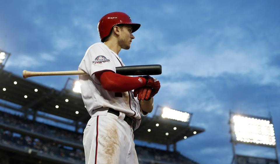 FILE - In this Thursday, Aug. 2, 2018, file photo, Washington Nationals' Trea Turner prepares to bat during a baseball game against the Cincinnati Reds at Nationals Park in Washington. Whatever progress baseball has made promoting inclusion, it took a backseat recently. Years-old racist, misogynist and homophobic tweets from Milwaukee reliever Josh Hader were found during the All-Star Game. Then Atlanta pitcher Sean Newcomb and Washington shortstop Trea Turner had their own offensive tweets unearthed. (AP Photo/Alex Brandon, File)