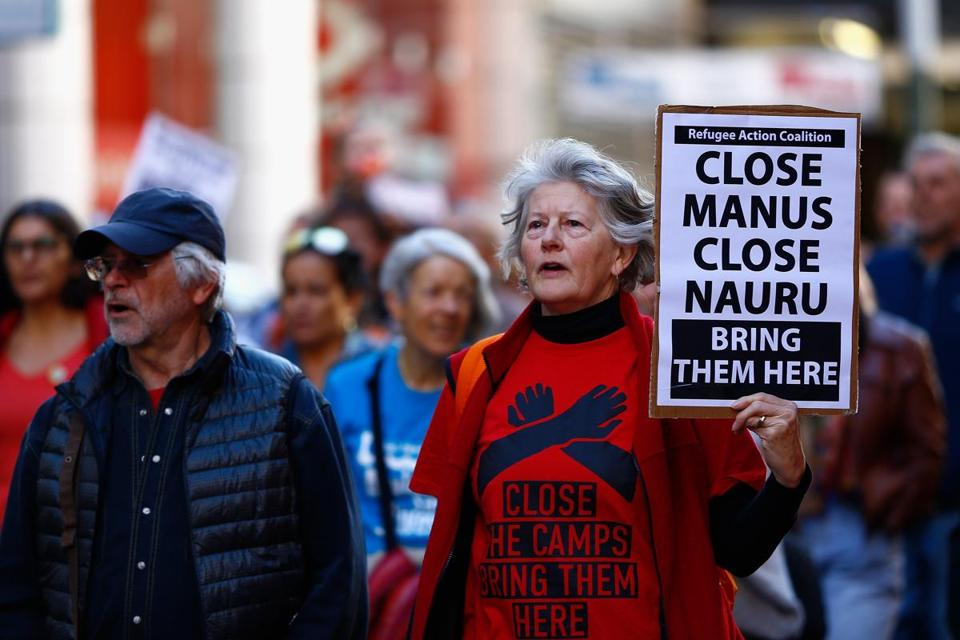 AUSTRALIA AND NEW ZEALAND OUT Mandatory Credit: Photo by JEREMY NG/EPA-EFE/REX/Shutterstock (9766941f) Protesters are seen during the Evacuate Manus and Nauru Protest - 'Five Years Too Long, 12 Deaths Too Many' Protest at Town Hall in Sydney, Australia, 21 July 2018. Refugee Action Coalition (RAC) Sydney organised a protest against mandatory offshore detention. Protest against mandatory offshore detention in Sydney, Australia - 21 Jul 2018