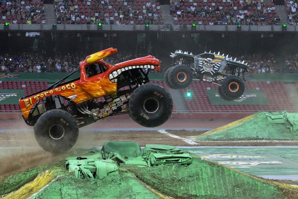 "Monster Jam trucks perform during the first-ever monster truck event in Beijing's iconic ""Bird's Nest"" National Stadium on Saturday, July 29, 2017. (AP Photo/Ng Han Guan)"