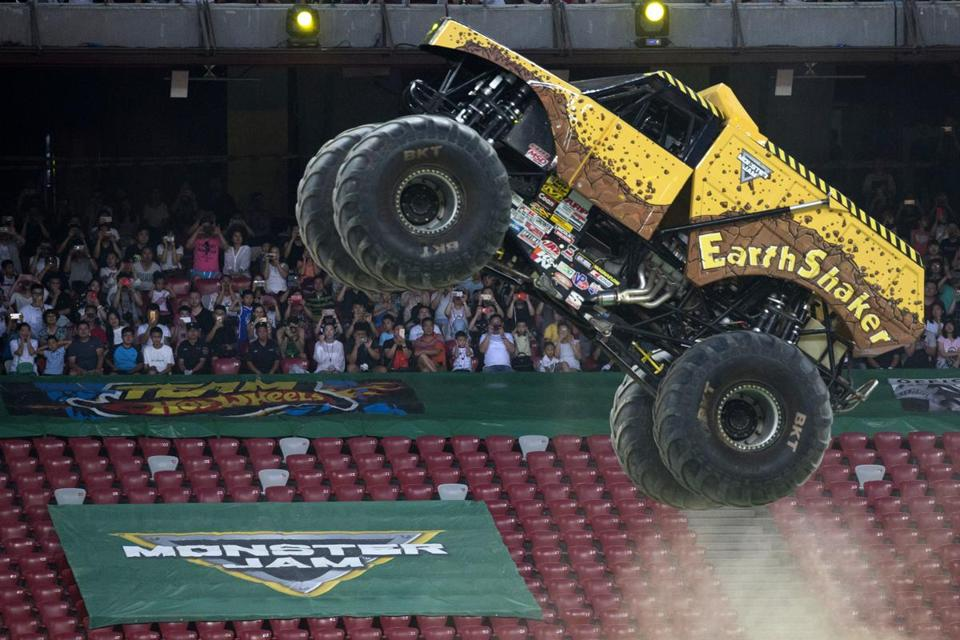 "A Monster Jam truck performs during the first-ever monster truck event in Beijing's iconic ""Bird's Nest"" National Stadium on Saturday, July 29, 2017. (AP Photo/Ng Han Guan)"