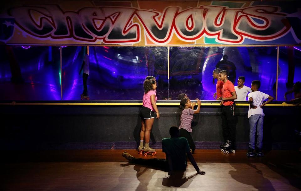 Boston, MA - August 09, 2018: A group of youths enjoy skating at Chez-vous Roller Rink in the Dorchester neighborhood of Boston, MA on August 09, 2018. The rink has been in operation for 85 years. (Craig F. Walker/Globe Staff) section: metro reporter: