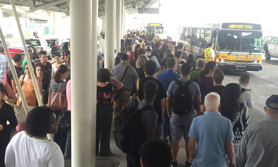 Passengers waited for shuttles at Airport Station Thursday morning.