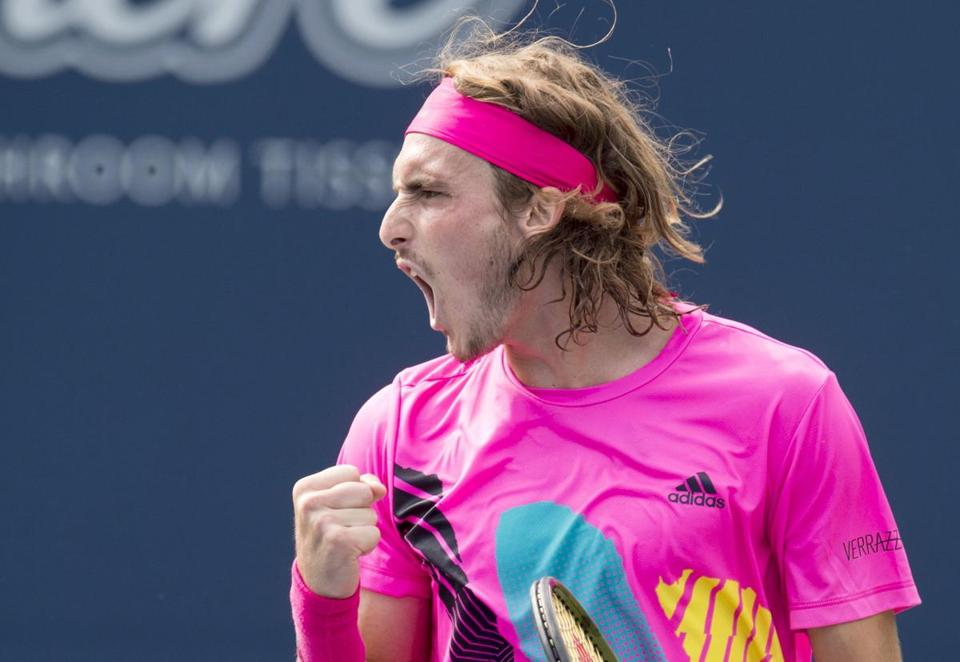 Stefanos Tsitsipas, of Greece, celebrates on his way to defeating Novak Djokovic, of Serbia, at the Rogers Cup men's tennis tournament in Toronto, Thursday, Aug. 9, 2018. (Frank Gunn/The Canadian Press via AP)