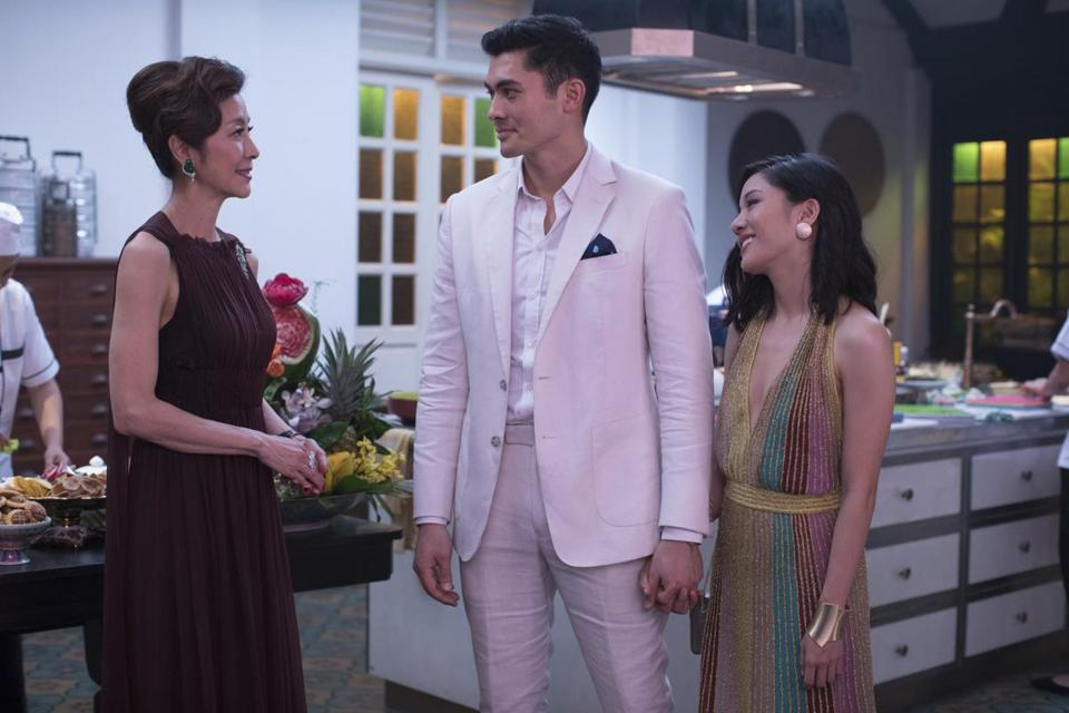 "Michelle Yeoh (left), Henry Golding, and Constance Wu in ""Crazy Rich Asians."""