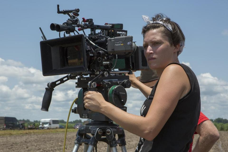 "This image released by Netflix shows Rachel Morrison on the set of the film ""Mudbound."" Morrison was the first woman nominated for an Oscar for best cinematography. Beginning Friday, Lincoln Center will feature 36 films shot by 23 female cinematographers as part of a two-week series, ""The Female Gaze."" (Steve Dietl/Netflix via AP)"