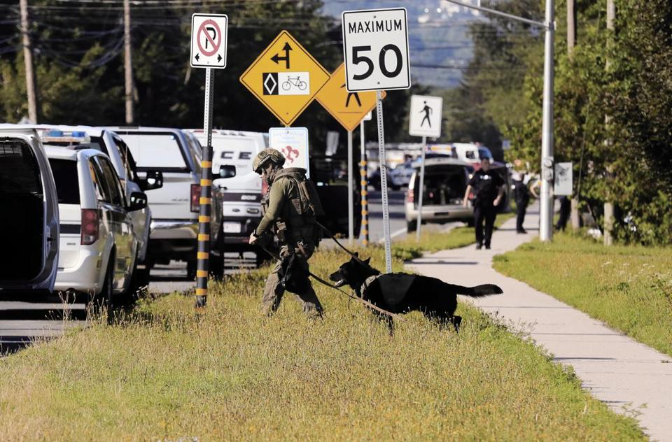 Police officers worked in an area of Fredericton, New Brunswick, Canada Friday after a shooting killed four people, including two police officers.