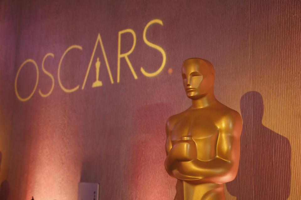 "FILE - In this Feb. 6, 2017 file photo, an Oscar statue is places inside the ballroom at the 89th Academy Awards Nominees Luncheon in Beverly Hills, Calif. When the Academy of Motion Pictures Arts & Sciences announced changes to next year's Oscars broadcast, including the controversial creation of a ""popular film"" category, it prompted a host of questions about what this means for the world's biggest awards show. (Photo by Danny Moloshok/Invision/AP, File)"