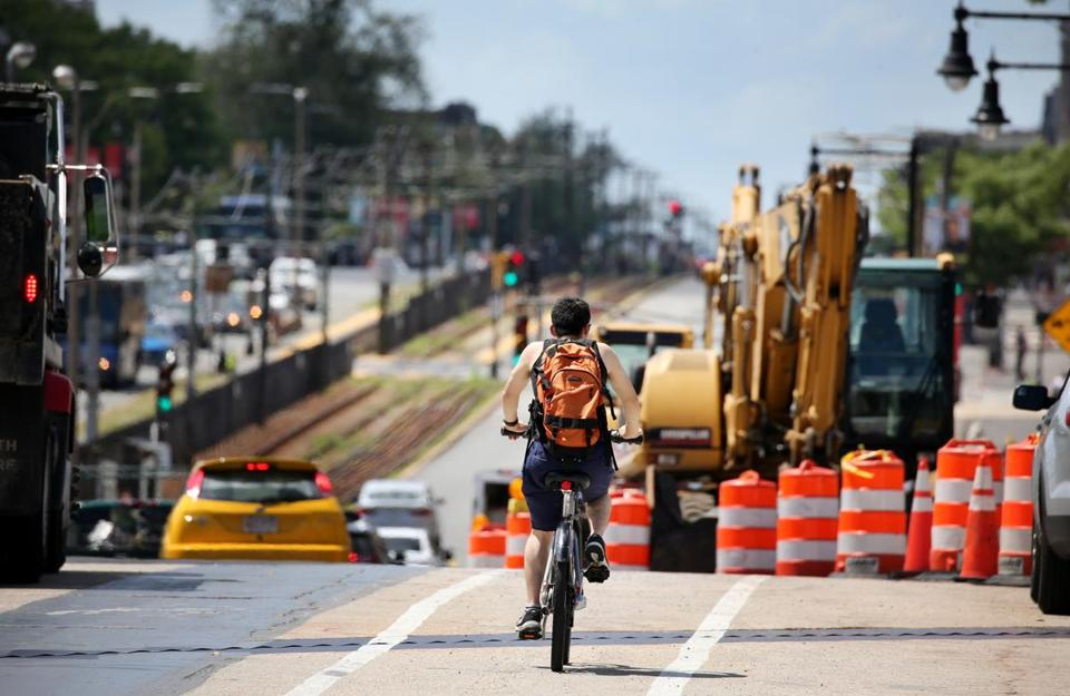 A cyclist navigated Commonwealth Avenue during construction.