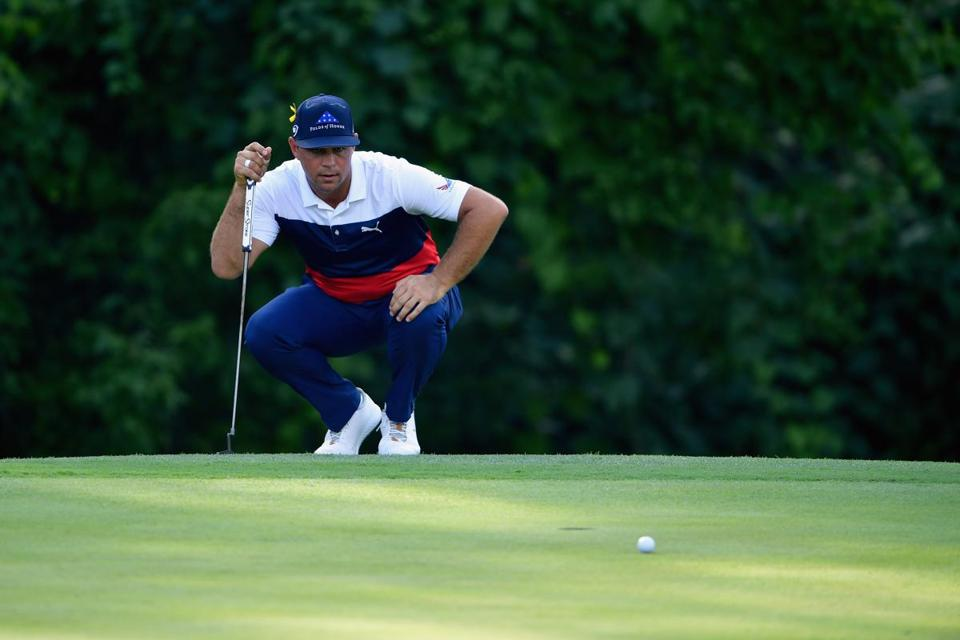 ST LOUIS, MO - AUGUST 09: Gary Woodland of the United States lines up a putt on the 17th green during the first round of the 2018 PGA Championship at Bellerive Country Club on August 9, 2018 in St Louis, Missouri. (Photo by Stuart Franklin/Getty Images)