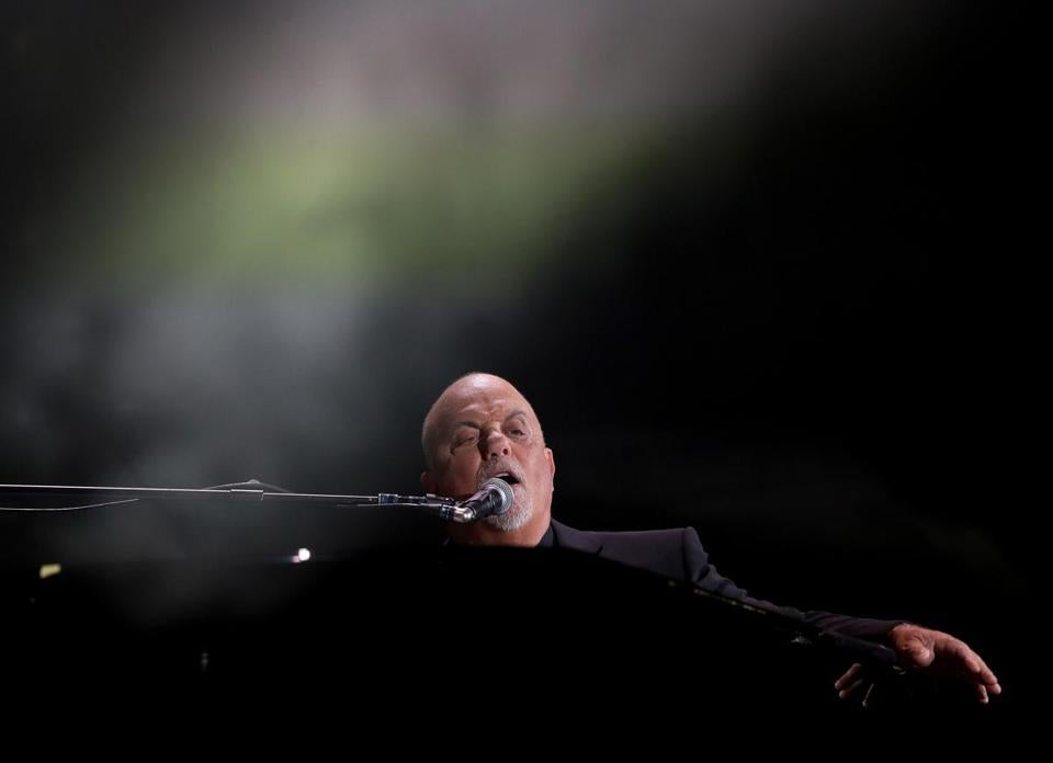Billy Joel performs at Fenway Park.
