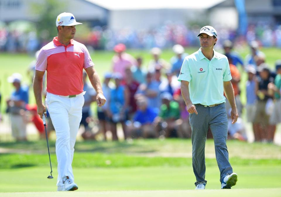 Gary Woodland (left) and Kevin Kisner kept an eye on each other while playing in the same group.