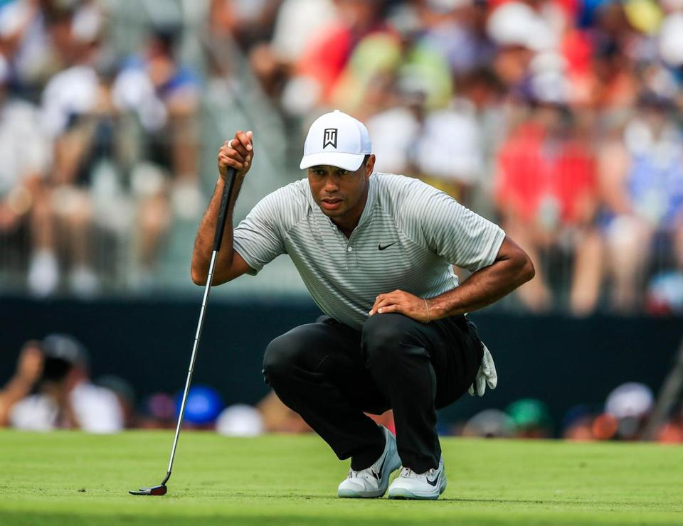 Tiger Woods lines up his putt on the third green Friday at the 100th PGA Championship in St. Louis.