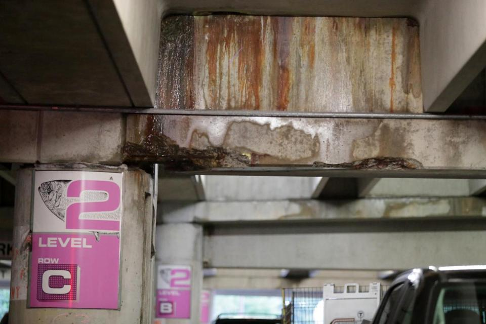 There are still multiple areas of crumbling concrete in the Alewife garage, which reopened Monday after weekend repairs.