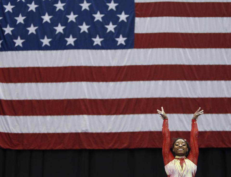 Olympic champion Simone Biles starts her routine on the the balance beam during the U.S. Classic gymnastics competition Saturday, July 28, 2018, in Columbus, Ohio. The U.S. Classic is Biles first competition since the 2016 Olympics. (AP Photo/Jay LaPrete)