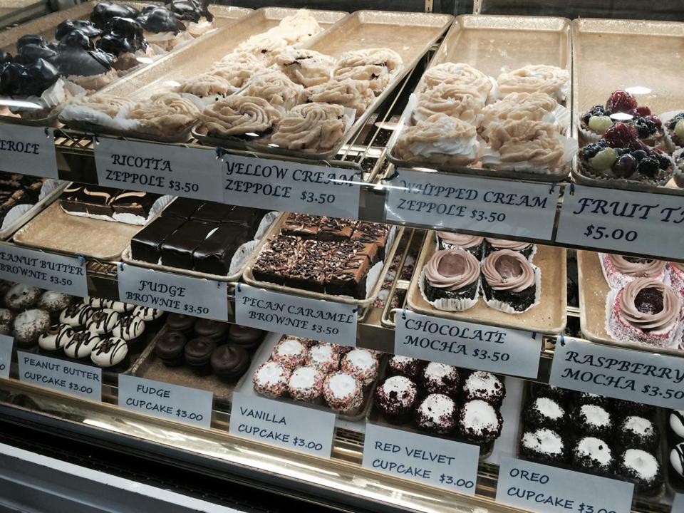 26helpdeskguests -- Most guests enjoy a tour of the sights in the North EndÑcapped with a visit to one of the famous pastry shops, like MikeÕs Pastry on Hanover Street. (Diane Bair)
