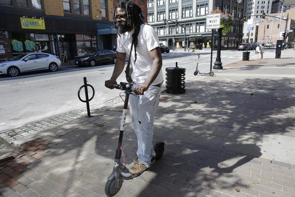 Vatic Kuumba rode an electric scooter in downtown Providence.