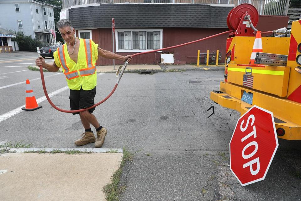 Highway department worker Michael Picanzo installed a new stop sign near the restaurant.