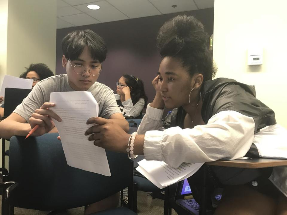 Clinton Nguyen (left) and Baja Beaman went over a draft during a Teens In Print class at Emerson College.