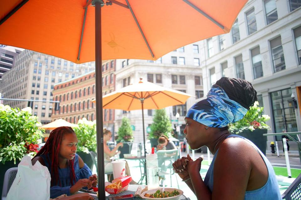 "Gail Cummings, right, shared lunch with her daughter Abygail Rudder at a table in the new ""parklet"" at the corner of Franklin and Arch streets."