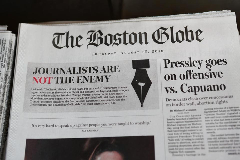 "CAMBRIDGE, MA - AUGUST 16: The front page of the Thursday, August 16, 2018 edition of the Boston Globe newspaper reads ""Journalists are Not the Enemy"" as it sits for sale at Out of Town News on August 16, 2018 in Cambridge, Massachusetts. Hundreds of U.S. newspapers joined together and published editorials decrying President Donald Trump's description of the media as the ""enemy of the people."" (Photo by Tim Bradbury/Getty Images)"