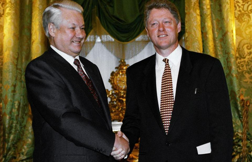 Russian President Boris Yeltsin, left, welcomes U.S. President Bill Clinton in St. George's Hall at the Kremlin Palace, Jan. 13, 1994. This is the first meeting of the three-day summit and the two will discuss a wide variety of issues of mutual interests. (AP Photo/Greg Gibson)