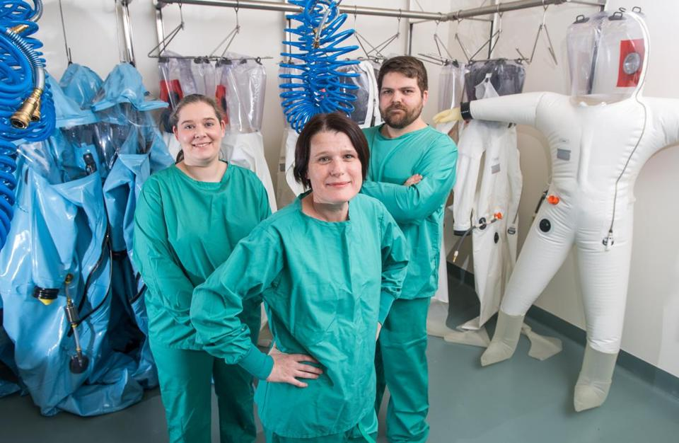 Judith Yulenik (left), Elke Mühlberger, and Adam Hume are ready to work at BU's new Biosafety Level 4 laboratory.