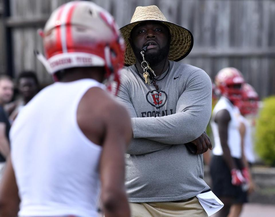 EVERETT, 8/17/2018 - coach Theluxon Pierre leads the first day of drills at perennial power Everett High, replacing former coach John DiBiaso after 27 years. Josh Reynolds for The Boston Globe (Sports, capen)