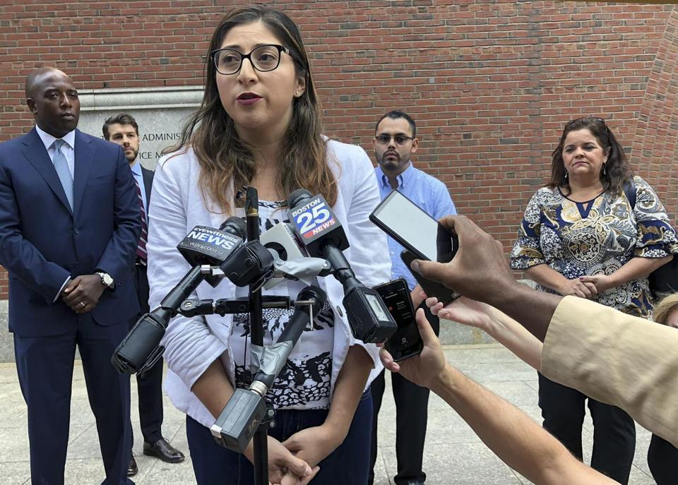Lilian Calderon, one of the people suing over the arrests of immigrants who showed up for hearings at government offices, answered questions outside federal court on Monday.