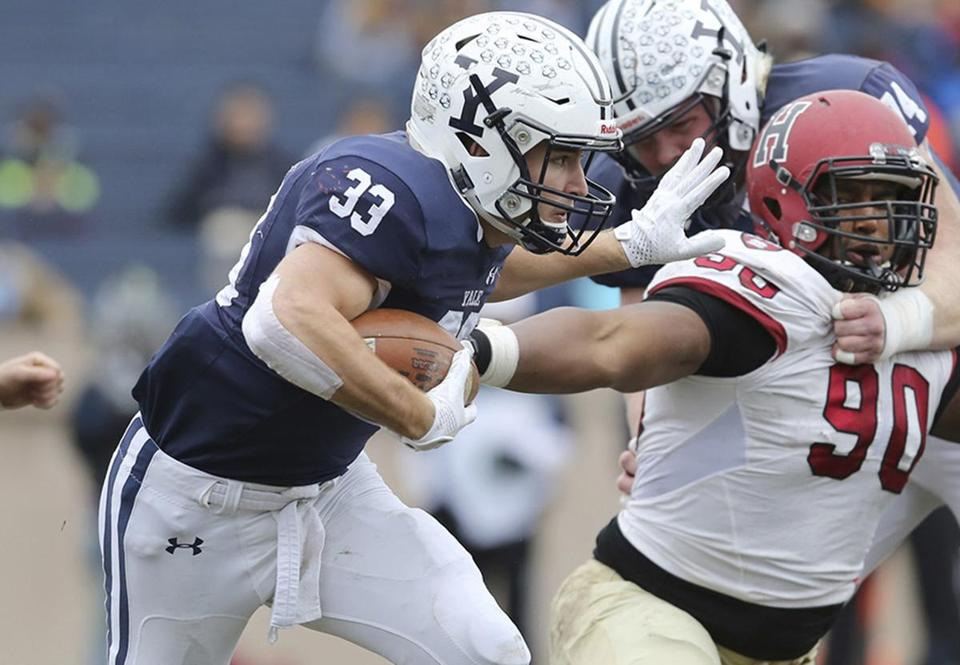 Yale's Zane Dudek #33 in action against Harvard during an NCAA college football game on Saturday, November 18, 2017 in New Haven, CT. Yale won the game 24-3 and won their first outright Ivy League title since 1980. (AP Photo/Gregory Payan)