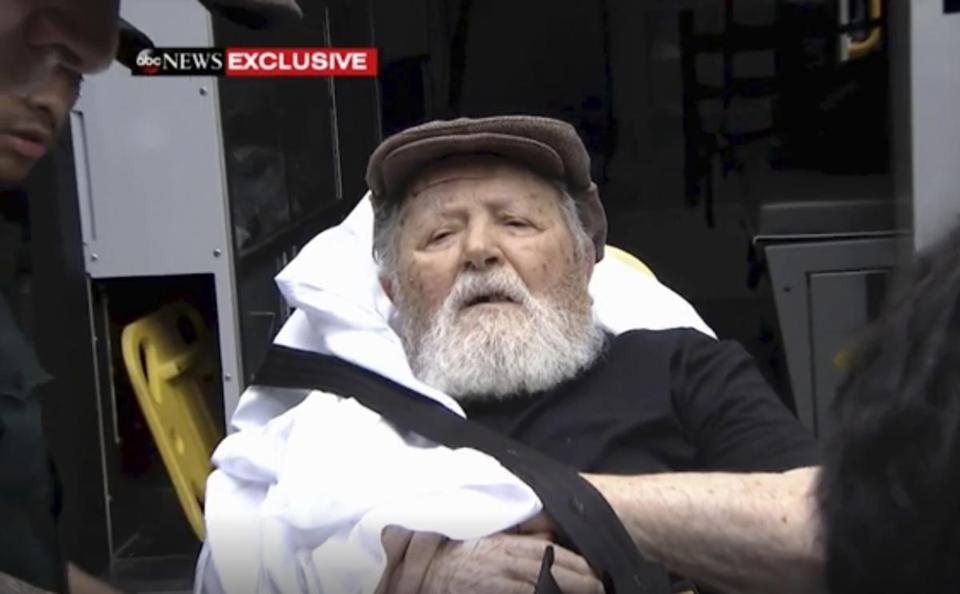 Jakiw Palij, a former Nazi concentration camp guard, is carried on a stretcher from his home in the Queens borough of New York. Palij, the last Nazi war crimes suspect facing deportation from the US was taken from his home on Tuesday.