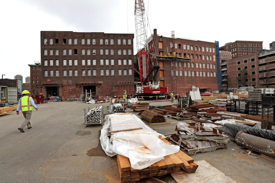 Work continued at the site of GE's new headquarters in Fort Point in August.