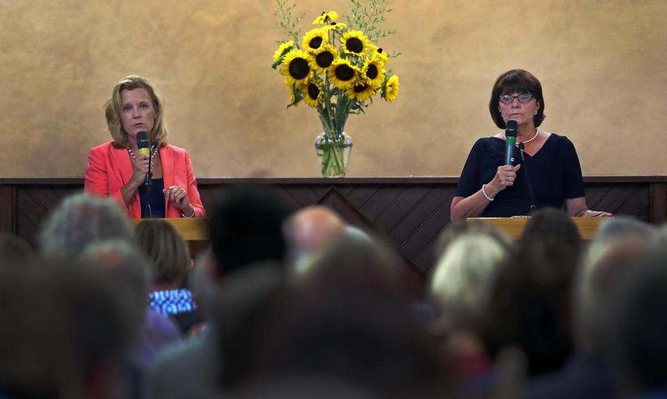 Arlington, MA: 7-24-18: Middlesex County District Attorney Marian Ryan (right) is pictured with challenger Donna Patalano, (left) who is running against her for the position. They are pictured during a debate held at the First Parish Church. (Jim Davis/Globe Staff)