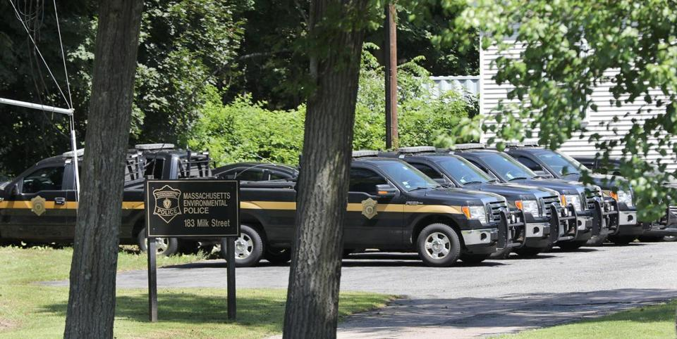 Vehicles for the Massachusetts Environmental Police parked at the office on Milk Street in Westborough.