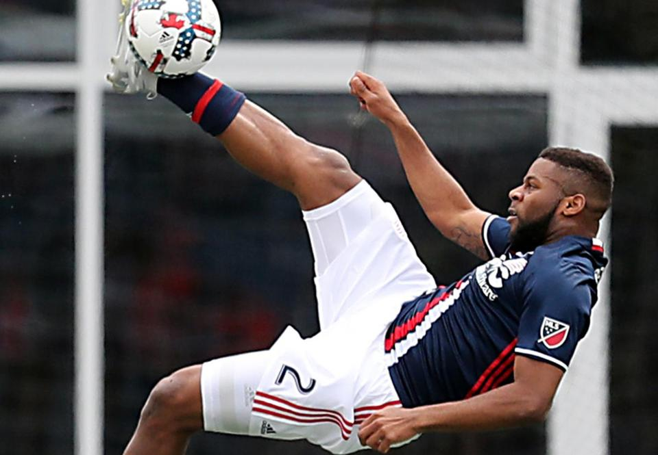 Foxborough MA 4/8/17 New England Revolution Andrew Farrell make a bicycle kick against the Houston Dynamo during first half action of their MLS game at Gillette Stadium. (Photo by Matthew J. Lee/Globe staff) topic: reporter: