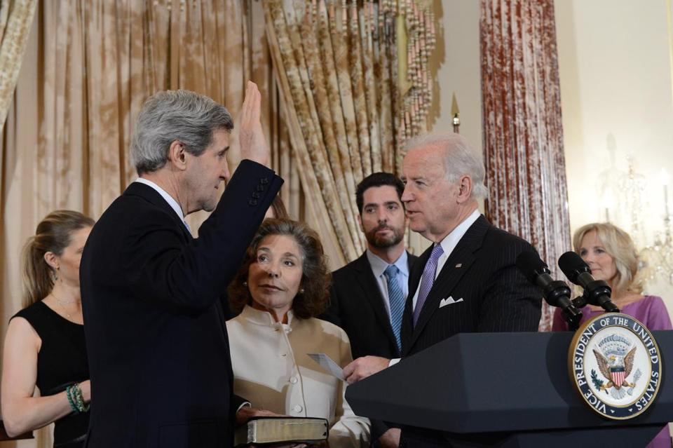 John Kerry is sworn in as secretary of state in 2013 by Vice President Biden.