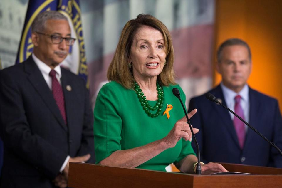 Of the 24 Democrats running for House seats in the Sept. 4 primary, only six say they'd back Nancy Pelosi (center) if she seeks another term as leader of the party in the House.