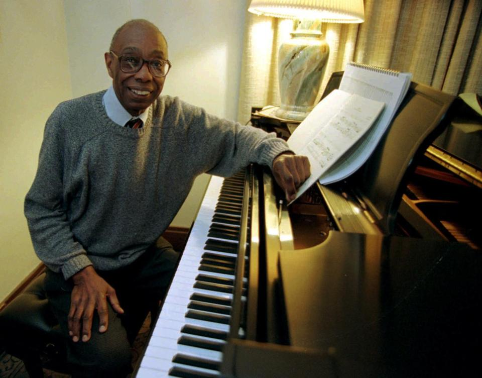 "Composer George Walker, 73, winner of the 1996 Pulitzer Prize for music, poses at his piano in his home in Montclair, N.J., on Tuesday, April 9, 1996. Walker, a retired Rutgers University professor, won for ""Lilacs,"" a 14-minute-long composition commissioned by the Boston Symphony Orchestra to honor Roland Hayes, the first black concert singer to appear with an American orchestra.(AP Photo/Mike Derer)"
