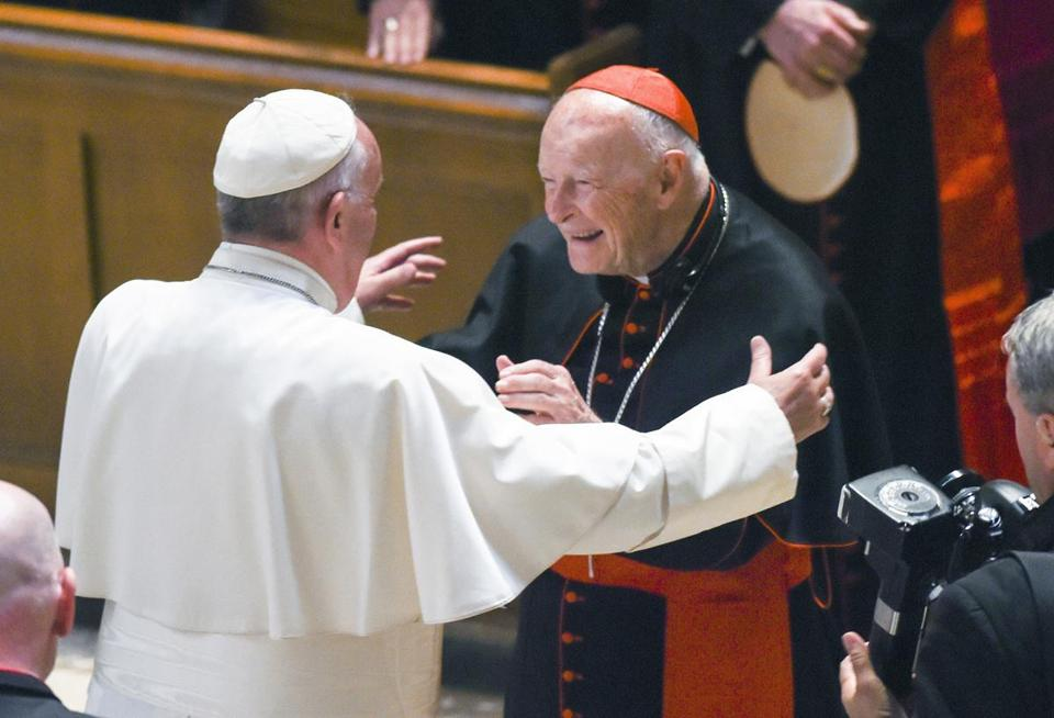 FILE - In this Sept. 23, 2015 file photo, Pope Francis reaches out to hug Cardinal Archbishop emeritus Theodore McCarrick after the Midday Prayer of the Divine with more than 300 U.S. Bishops at the Cathedral of St. Matthew the Apostle in Washington. Seton Hall University has begun an investigation into potential sexual abuse at two seminaries it hosts following misconduct allegations against ex-Cardinal McCarrick and other priests. (Jonathan Newton/The Washington Post via AP, Pool, File)