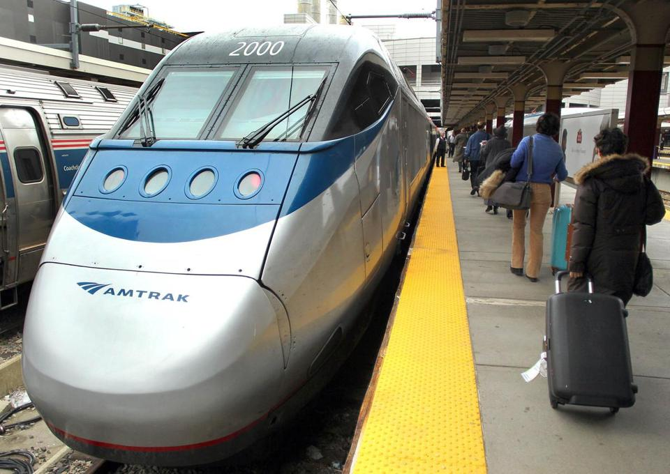 At South Station, passengers board the Acela for a trip to Washington, D.C.