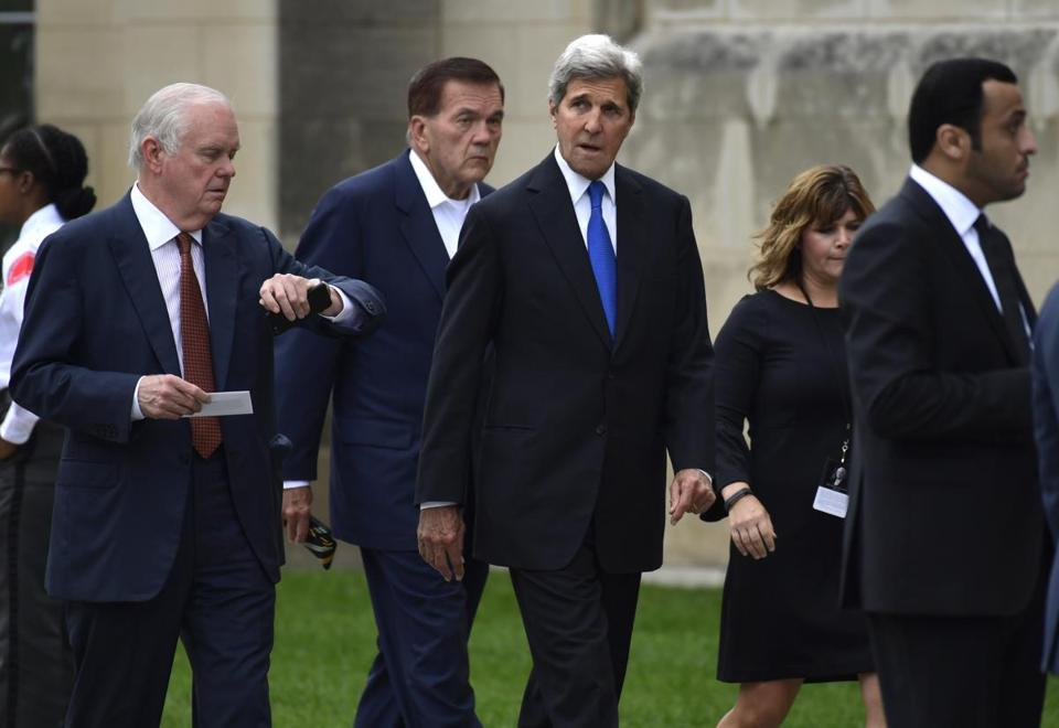 Former Secretary of State John Kerry, center, arrived to attend a memorial service for Senator John McCain at the Washington National Cathedral on Saturday.