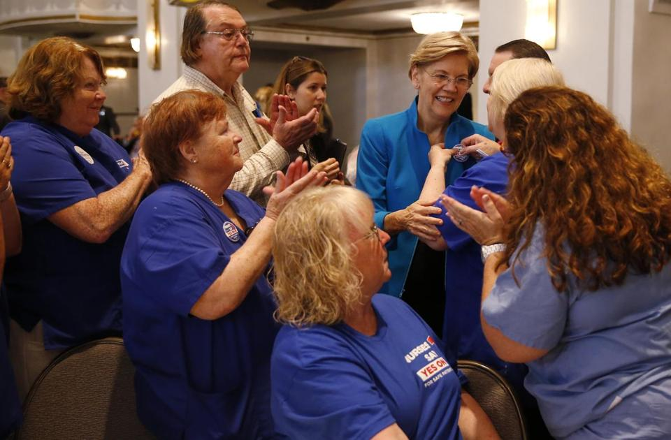 US Senator Elizabeth Warren accepted a pin from a group representing nurses at the Greater Boston Labor Council's Annual Labor Day Breakfast on Monday.