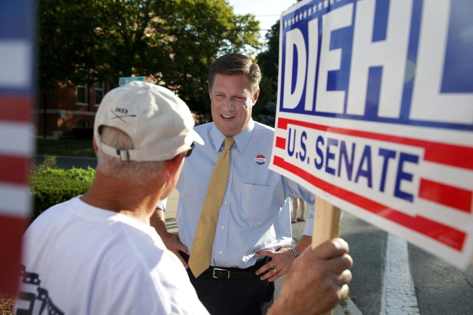 Geoff Diehl with a supporter after voting at the Whitman Town Hall.
