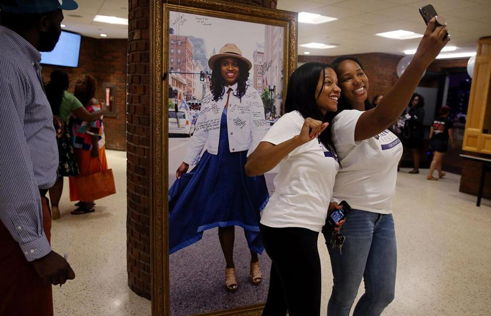 Boston, MA - September 04, 2018: Courtney Leonard, left, and Lianne Hughes make a selfie with a portrait of Ayanna Pressley during the Ayanna Pressley for Congress campaign primary night celebration at IBEW Local 103, in Dorchester, MA on September 04, 2018. Ayanna Pressley is a Boston City Councilor and Democratic candidate for the Massachusetts 7th Congressional District. (Craig F. Walker/Globe Staff) section: Metro reporter: slider
