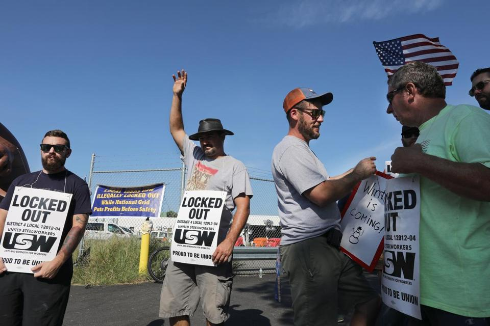 Locked-out union workers recently picketed outside the National Grid gas facility yard in Malden.