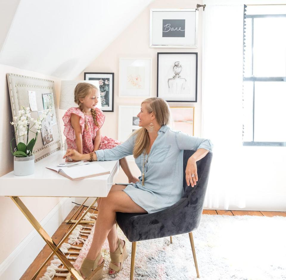 Homeowner and designer Jenny Minns in her home office with her daughter, Isabelle.