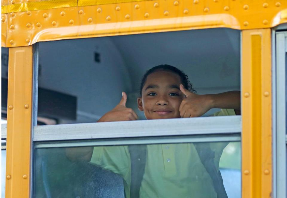 BOSTON, MA - 9/06/2018: A student goes thumbs up on the bus for Back To School for City of Boston students.... (David L Ryan/Globe Staff ) SECTION: METRO TOPIC 07bps