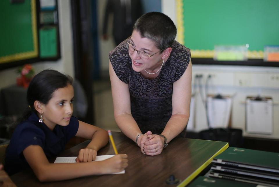 Interim schools superintendent Laura Perille with student Yenny Arango at the Samuel Adams Elementary School in East Boston on Sept. 9.